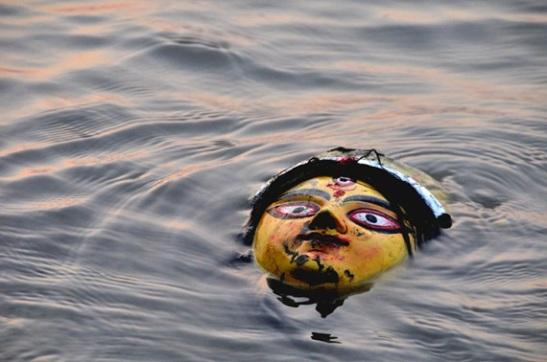 immersion of durga idols, durga puja celebration in usa, cheap flights to india